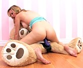 Busty blonde Brett Rossi plays with a stuffed bear