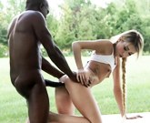 Slim blonde with a ponytail fucks with a black man in public