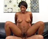 Spicy black babe has sex on couch