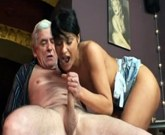 A young barmaid fucks with older man at his table