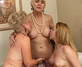 Two mature women seduce young girl