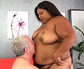 Ebony plumper gets kissed on her tits belly and ass Then she takes the white dick in her mouth and give blowjob