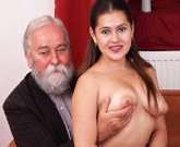 Young horny girl with big tits fucks with a grandpa